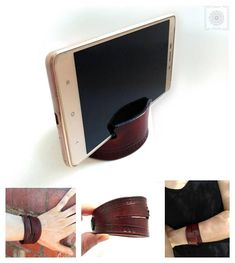leather cuff — gadget. Smartphone stand.