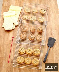 """EZ Expanding Bakeware Racks are versatile additions to your kitchen. The Cooling Rack (13-3/4""""W x 14-1/4""""D x 1-1/2""""H, closed, expands to 35-1/2""""D) has a space-saving design that is easy to store. It opens from 1 large rack into 3 connected sections in se"""
