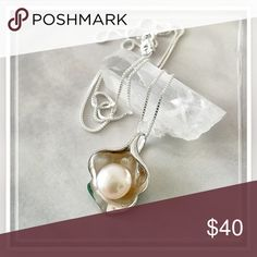 """✨Sterling Silver Calla Lily & Pearl Necklace✨ ✨Pure feminine grace, the calla lily has a graceful form that artists can't resist✨This beautiful, stylized one is represented in sterling with it's heart accented by a luminescent peach hued 8mm genuine button freshwater pearl✨This petite pendant is wonderfully designed with a hidden bail made up of a curve of the base of the petals✨It measures 1/2"""" x 3/4"""" and is marked 925✨Comes with a 22"""" Silver Plated Chain✨Pendant is Solid Sterling Silver✨…"""