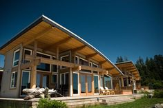 The conventional wood framing members and Douglas fir posts and beams under the curved rooflines that give this developmen...