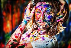 Awesome Senior Photoshoot with Paint! So cool and colorful!! Senior pics in Michigan. #arisingimages #creative #photoshoot #paint #colorful #senior #ideas #pose