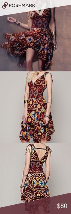 FREE PEOPLE  ONE Wisteria Dress Technicolor V-Neck party dress, boho printed with plunging neckline and full, layered skirt. Sweet tie details on the shoulders. Stretchy waistband. Fit for a fiesta! *FP One is an exclusive collection made with love from India. Defined by bold embellishments and natural-feeling fabrics, the collection brings a modern twist to old world techniques.  Care/Import  100% Cotton Hand Wash Cold *Import Free People Dresses Mini