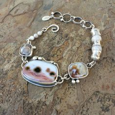 I have made each component of this bracelet in my home studio. The main ocean jasper stone measures 1.25 by 0.75 at its widest point.    This