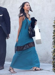 Casual but cool: Zoe Saldana opted for laid-back boho style for a shopping trip in Beverly Hills on Wednesday, breezing along in a blue maxi dress