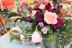 Spring Floral Design sure to brighten up any table of guests with bright pinks, corals and oranges