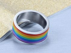 Item Description - Gender: Unisex - Material: Metal - Occasion: Party - Metals Type: Stainless Steel - Shape\pattern: Geometric - Design: Rainbow striped ring Shipping & Handling This Item is eligible