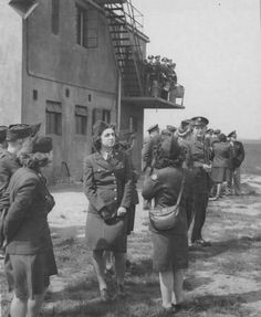 Wacs Attached To An 8th Air Force Base In England Gather Around The Control Tower To Watch For Planes Returning From A Mission. 30 April 1944 ~