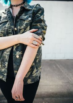One of my top tips for styling a camo jacket? Accessorize like crazy! The masculine camo print looks fantastic with oversized rings - click through to see the whole look!