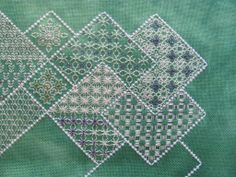 White threads on green - another variation from Tracey L www.blackworkjourney.co.uk