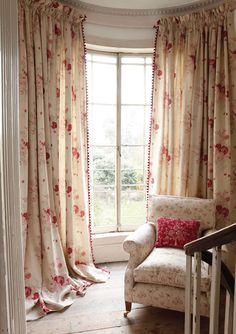Draperies for a curved window with trim on leading edge.