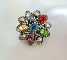The entire $15 goes to charity. Vintage Multicolored Rhinestone Brooch by VJSEJewelsofhope on Etsy, $15.00