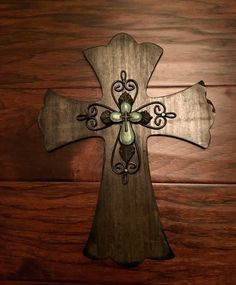 A personal favorite from my Etsy shop https://www.etsy.com/listing/469557292/9-x-12-black-cross-with-green-inlay