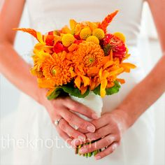 orange, gold and yellow bouquet included a ton of seasonal and local flowers: ranunculus, zinnias, dahlias and poppies.