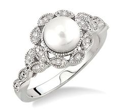 This Cultured Pearl And Diamond Ring Creates A Legendary Look For Today's Women. Gorgeous Ring Is Graced With A White Pearl Nestled Amid A Stream Of 12 Single Cut Diamond Accents, Beautifully Prong Set In Luminous Sterling Silver. Total Diamond Weight Is 1/20 Cttw And Pearl Measures 6.5mm - $129.00