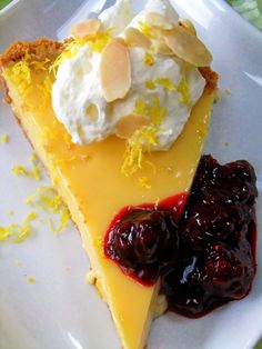 Limoncello Tart with Amaretti Cookie Crust and Berry Sauce