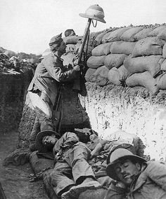 Soldier checks for snipers in the trenches of Gallipoli, 1915.
