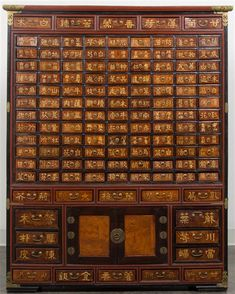 A Korean Apothecary Chest, Height 52 x width 42 x depth 12 inches.