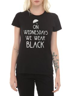 """Fitted black tee from American Horror Story: Coven with """"On Wednesdays We Wear Black"""" text design."""