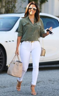 Eva Longoria keeps it classy in oversized aviators with flash lenses to complement her flawless ensemble.