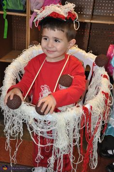 Trina: My son Matteo wore this one year. It was pretty simple to make I bought a laundry basket and hot glued white yarn for the spaghetti and a few pieces...