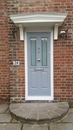 Solidor Composite Door in French grey with Victorian glass, a Brushed Aluminium doctor knocker, pull knob and letterplate Installed in Nottingham. Grey Composite Front Door, Grey Front Doors, Front Doors With Windows, Front Door Colors, Front Door Steps, House Front Door, Glass Front Door, External Front Doors, Victorian Front Doors