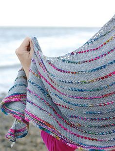 This is the lovely Loop shawl pattern by @casapinka - It shows off variegated and handpsun yarn really well! It's in my queue and I'm cooking up ideas :)