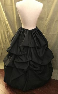 This is the regular fullness version of this skirt style we also offer the extra full version, see our listing for our Victorian Angel Skirt  This is a gorgeous skirt that goes with so many different outfits.  Wear it with a corset, blouse, or Victorian jacket!  This beauty of a skirt is made of 3 yards of cotton. It is made to wear over a hoop skirt or a petticoat (not included but recommended) The skirt has a 108 inch bottom sweep (circumference).  The skirt is meticulously hand draped and…