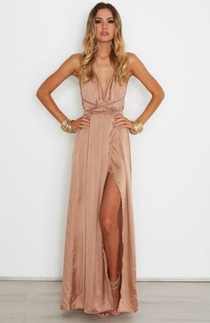 "<p><strong style=""font-family: arial, helvetica, sans-serif;"">Description</strong><br /><span style=""font-family: arial, helvetica, sans-serif; font-size: small;"">- Satin Look Maxi Dress</span><br /><span style=""font-family: arial, helvetica, sans-serif; font-size: small;"">- Halter Neck Straps that Wrap Around Waist</span><br /><span style=""font-..."