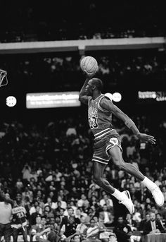 Michael Jordan of the Chicago Bulls attempts a dunk during the 1988 Slam Dunk Contest on February 1988 at Chicago Stadium in Chicago, Illinois. Michael Jordan Poster, Michael Jordan Tattoo, Michael Jordan Pictures, Michael Jordan Shoes, Michael Jordan Dunking, Michael Jordan Basketball, Michael Jordan Chicago Bulls, Mvp Basketball, Jordan Bulls