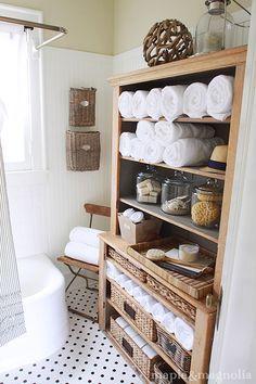 bathroom storage (can add short bookshelf to cabinet) LOVE the ticking shower curtain!
