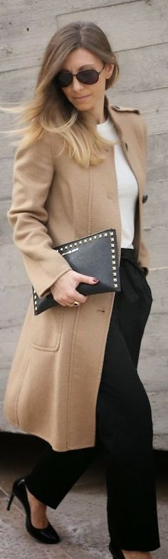 Camel colour coat , black leather clutches with high heels