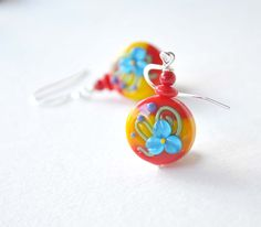 A personal favorite from my Etsy shop https://www.etsy.com/listing/222404376/red-flower-earrings-floral-earrings