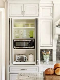 We think of the kitchen as the hub of the home, and with so much cabinetry, kitchen goods and food, it's a space that can easily become chaotic. But it's also a space that can stand out when it's managed well!
