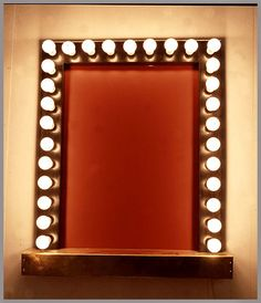 I always wanted a dressing table mirror with theatrical light bulbs :)