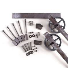 This is a BEAUTIFUL 5-8 foot rustic steel sliding barn door hardware set. Made in the USA from high quality steel. ( Lifetime Warranty ) Includes: