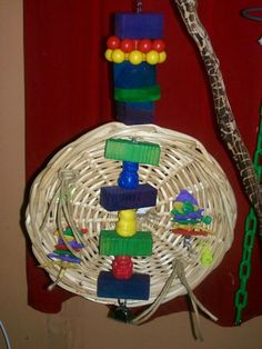 Another wicker tray toy idea by Laura Lewis. Posted on Facebook, The Parrot's Workshop, https://www.facebook.com/groups/TheParrotsWorkshop/permalink/232875243500981/