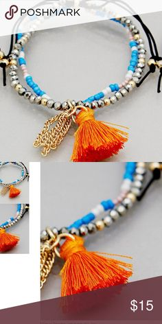 Beaded bracelet with orange tassel HAPPY BRACELET, TRENDY TASSEL IN ORANGE!!!  On 2 strand beaded bracelet, 1 strand is metallic the other is light blue and white. Wear all summer long!!! BEE and BELLE Jewelry Bracelets