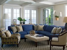This is pretty much how my family room will look, upholstery wise...except with a camel mohair sofa and the blue on the accent chair
