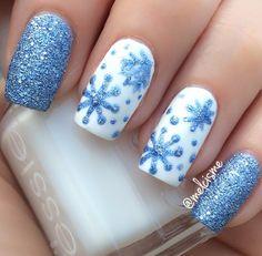 Snowflake nail design by Instagram user melcisme   #winternails #essie #glitter #snowflake #snowflakenails