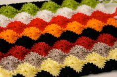 Are you a fan of the popular television show, Breaking Bad? If so, you may have noticed a crocheted afghan in the background of the action. Learn how to make your own Breaking Bad Afghan using the Wheel Stitch.