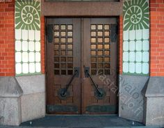 art nouveau church door, finland:: mix of textures and materials, heavy and light, dark and bright