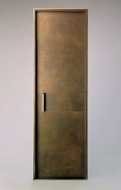 Bronze clad interior door and jam with custom handle