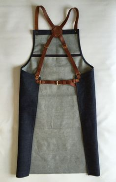 Denim apron with veg tan leather pocket and crossback straps. Silversmith, crafter, barber, barista,chef apron. #Etsyworkwearteam #workwear