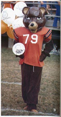 Sammy the Bearkat and commemorative plate celebrating 100 of Sam Houston State University.