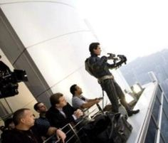 Christopher Nolan watches Christian Bale prepare for a scene in The Dark Knight.