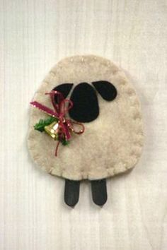 """Woolly Lamb Ornament"""". SKU: O 939. Measures 3 3/4"""" high. By Countryside Patterns."""