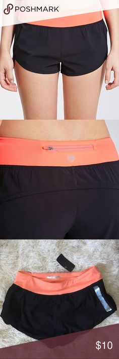 Forever 21 peach running shorts. New with tags. Very cute XS running shorts black with peach detailing. Never worn new with tags. Very comfortable and perfect for running. lululemon athletica Shorts