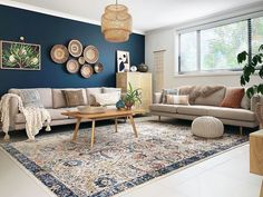 A guide to the 10 most popular interior design styles. Deep teal feature wall, baskets on wall as wall art, rattan pendant light, printed rug in the living room Teal Living Rooms, Living Room Colors, Home Living Room, Interior Design Living Room, Living Room Designs, Living Room Decor, Interior Design Guide, Blue Feature Wall Living Room, Living Room Wall Lighting