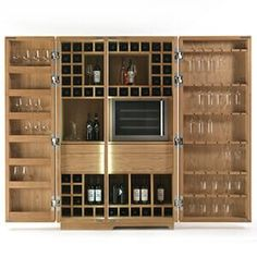The Cambusa offers an array of functional storage solutions, with twin strips of LED sensors transforming a sophisticated yet humble design into a show stopping centrepiece.Grids of horizontal wine holders are flanked by compartments for standing wines Wine Bar Cabinet, Drinks Cabinet, Wine Cabinets, China Cabinet, Bar Furniture, Cabinet Furniture, Armoire Bar, Humble Design, Home Bar Designs