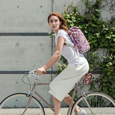 Summer city cycling with our Limited edition Liberty print rucksack and saddle bag.